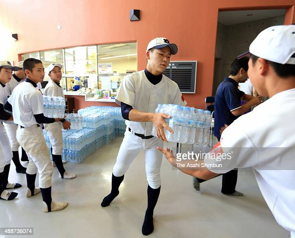Baseball club members of Shimotuma Daini High School volunteer at an evacuation center on September 12 2015 in Joso Ibaraki Japan The swamped area...