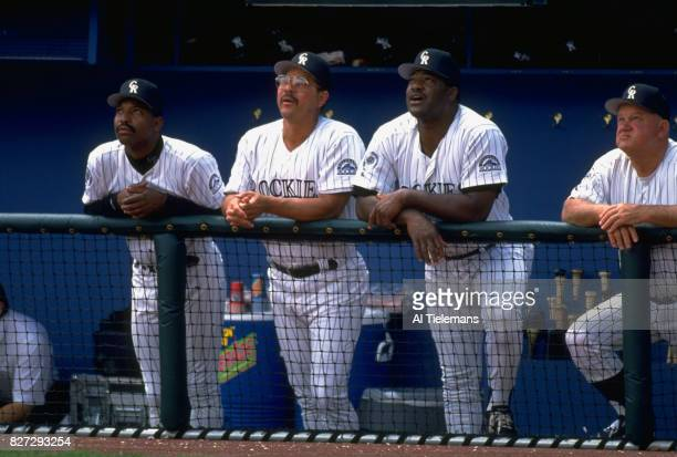 Colorado Rockies third base coach Jerry Royster hitting coach Amos Otis manager Don Baylor and bench coach Don Zimmer in dugout during game vs...