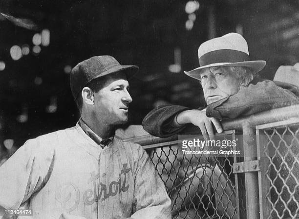 Baseball Commissioner Judge Landis right visits with Tigers' manager Bucky Harris before a spring training game on March 23 1932 at Wrigley Field in...