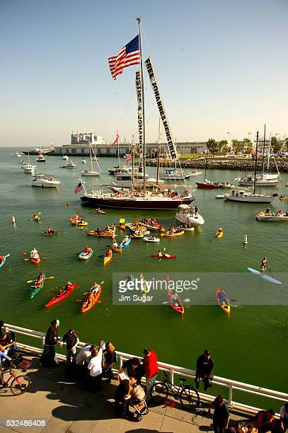 A baseball crowd at jampacked ATT Park as the San Francisco Giants play the Philadelphia Phillies Giants fans in a variety of watercraft floating in...