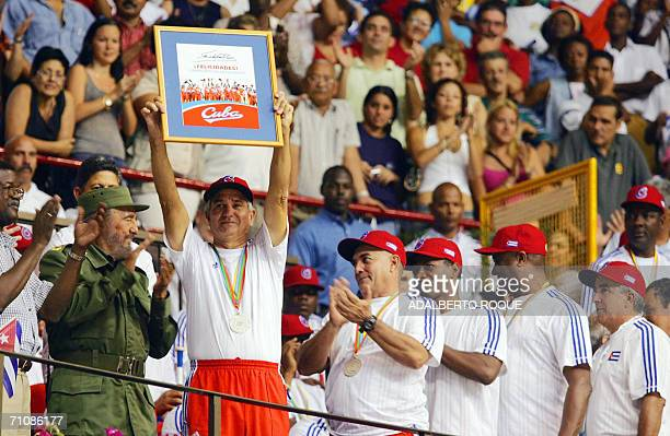 Baseball Cuban national team coach Higinio Veliz shows in Havana 21 March 2006 a diploma given by Cuban President Fidel Castro in recognition of the...