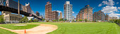 Baseball diamond Queensboro Bridge Manhattan apartment buildings New York panorama
