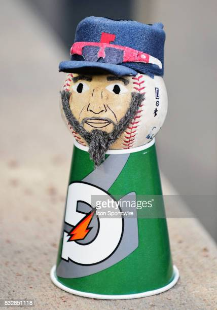 A baseball doll made to look like Cleveland Indians Pitcher Danny Salazar sits on the top step of the Cleveland Indians dugout during a MLB game...
