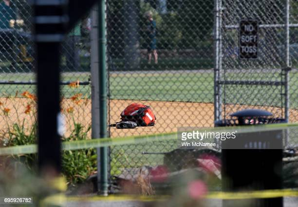 Baseball equipment lays on the infielf at Eugene Simpson Field the site where a gunman opened fire June 14 2017 in Alexandria Virginia Multiple...