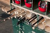 Baseball equipment rack in the dugout.