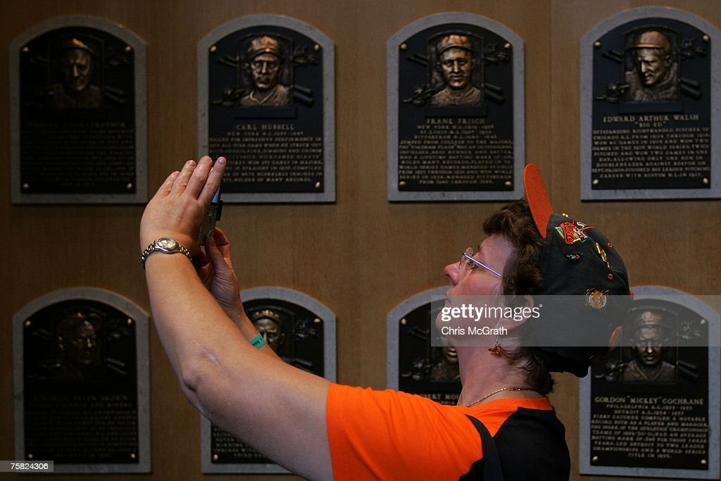 A baseball fan takes a picture of player plaques at the National Baseball Hall of Fame on July 27, 2007 in Cooperstown, New York. Thousands of baseball fans have arrived in Cooperstown for this weekends Hall of Fame induction ceremony of baseball legends Cal Ripken Jnr and Tony Gwynn.