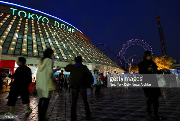 Baseball fans arrive for Game 1 of the Japan AllStar Series between the MLB AllStars and the Nippon Professional Baseball AllStars at the Tokyo Dome