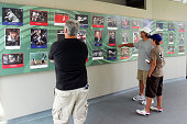 Baseball fans look at winning results of the Baseball Hall of Fame photography contests at the National Baseball Hall of Fame and Museum during the...