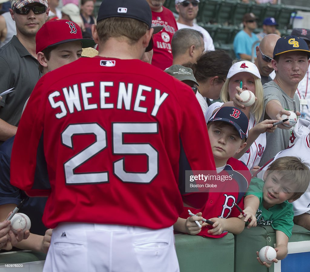 Baseball fans waiting for a Boston Red Sox player Ryan Sweeney to sign autographs autograph before the Red Sox play Northeastern University and Boston College in exhibition games during spring training at JetBlue Park on Thursday, Feb. 21, 2013.