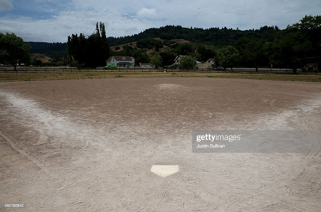 A baseball field is seen with dried grass in the outfield and a dirt infield on July 15, 2014 in Nicasio, California. As the severe drought in California contiues to worsen, the state's landscape and many resident's lawns are turning brown due to lack of rain and the discontinuation of watering.
