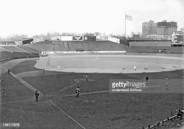 A baseball game at Yankee Stadium with no one in the bleachers New York New York mid 1920s