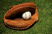 Baseball glove and ball, close-up