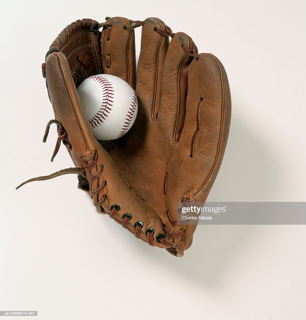 Baseball glove and ball on white background