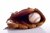a baseball and leather glove on a white background with a reflection in the table
