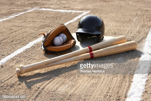 Baseball glove, balls, bats and baseball helmet at home plate : Stock Photo