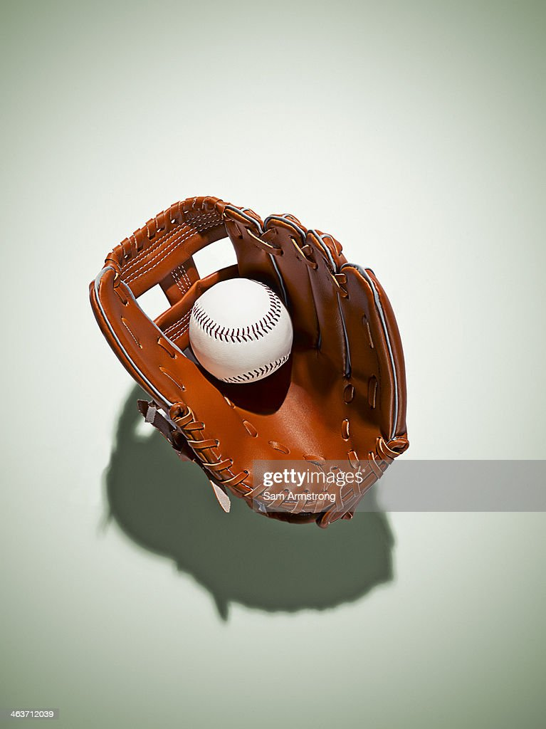 Baseball glove in catchers mitt