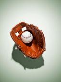 Baseball glove in catchers mitt