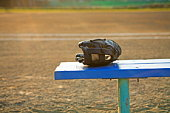 Baseball glove on bench