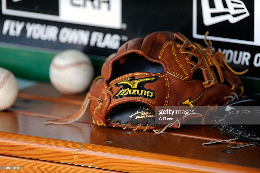 A baseball glove on the ledge in the dugout during the game between the Washington Nationals and the Miami Marlins on Opening Day at Nationals Park on April 1, 2013 in Washington, DC.