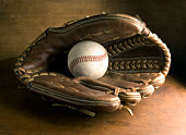baseball glove on wood