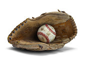 Old Worn Glove and Baseball Isolated on a White Background.