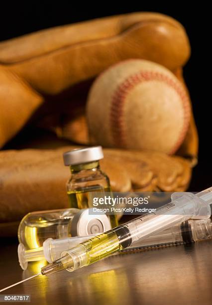 Baseball glove with syringes and vials