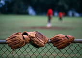 Baseball gloves on wire mesh fence