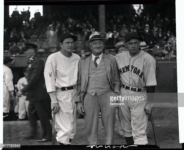 Honus wagner posing with joe cronin and new york giants bill terry