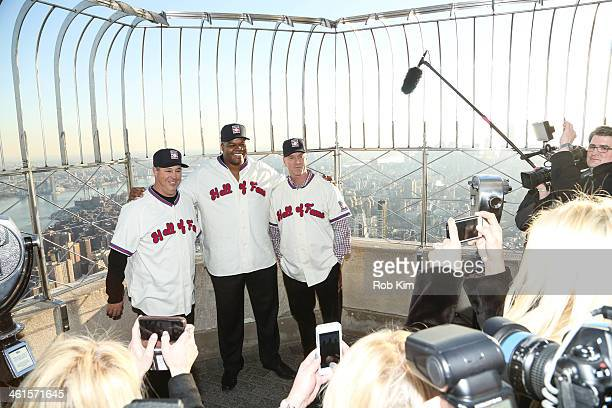 2014 Baseball Hall of Fame Electees Greg Maddux Frank Thomas and Tom Glavine visit at The Empire State Building on January 9 2014 in New York City