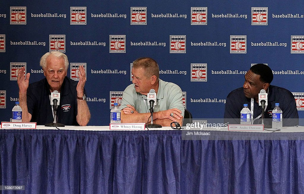 Baseball Hall of Fame inductees (L-R) Doug Harvey, Whitey Herzog, and <a gi-track='captionPersonalityLinkClicked' href=/galleries/search?phrase=Andre+Dawson&family=editorial&specificpeople=206316 ng-click='$event.stopPropagation()'>Andre Dawson</a> speak to the media during induction weekend at Cooperstown Central School on July 24, 2010 in Cooperstown, New York.