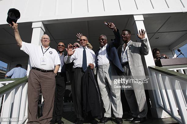 Baseball Hall of Famers wave to fans following ceremonies opening the Hank Aaron Museum at the Hank Aaron Stadium on April 14 2010 in Mobile Alabama...
