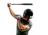 Baseball hitter swings the bat in preparation.