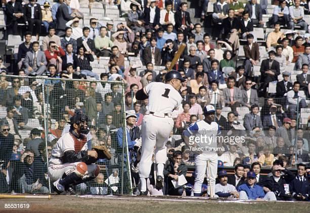 Home Run Hitting Contest Tokyo Giants Sadaharu Oh in action at bat while Atlanta Braves Hank Aaron watches during contest at Korakuen Stadium Tokyo...