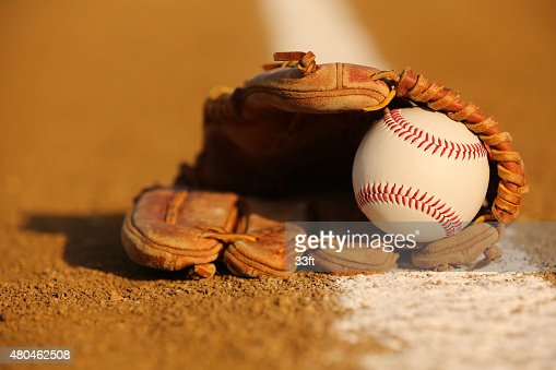 Baseball in a Glove on the Infield : Stock Photo