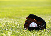 Baseball in Glove on Grass