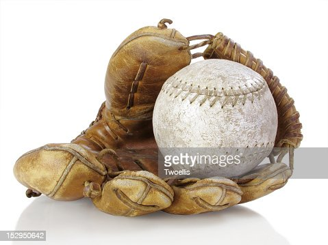 A baseball inside of a baseball glove : Stock Photo