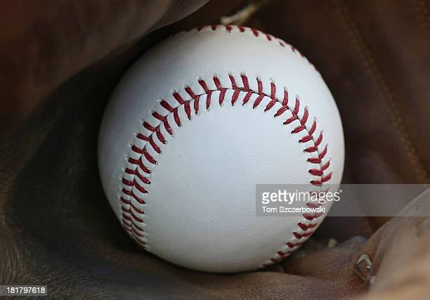 A baseball inside the catcher's glove of Chris Snyder of the Baltimore Orioles before the start of MLB game action against the Toronto Blue Jays on...