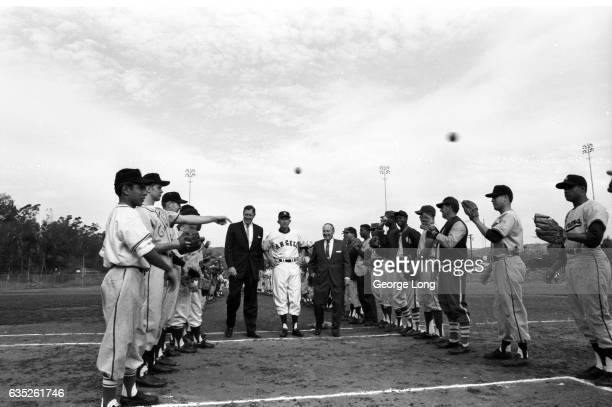 Los Angeles Angels President Bob Reynolds Manager Fred Rigney and General Manager Fred Haney walking among prospects during tryouts at Wrigley Field...