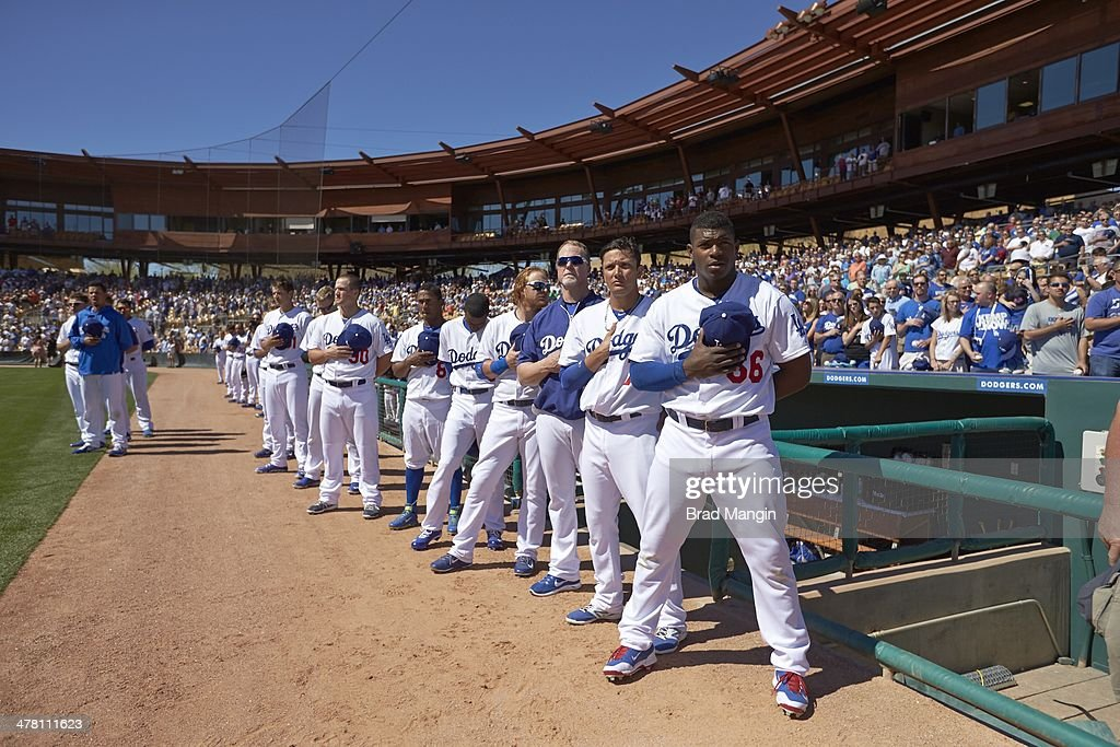 Los Angeles Dodgers Yasiel Puig (66) and teammates standing for national anthem before spring training game vs San Francisco Giants at Camelback Ranch. Brad Mangin TK1 )
