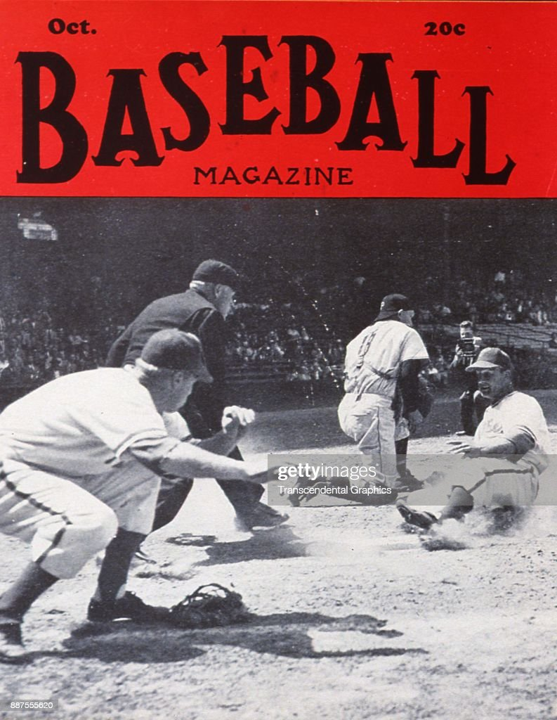 Baseball Magazine features a photo of onfield action as Stan Musial (1920 - 2013) (right), of the St Louis Cardinals, slides into home plate during a game against the Pittsburgh Pirates, October 1948.