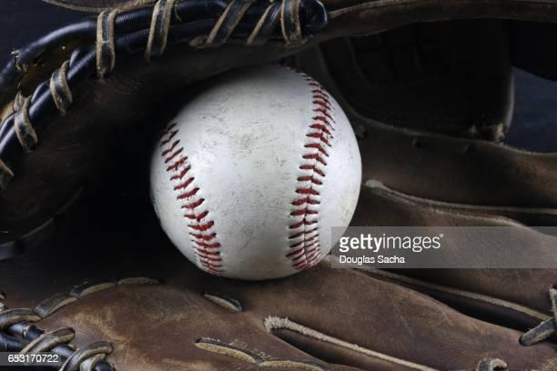 Baseball mitt with hard ball