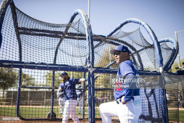 MLB Season Preview Los Angeles Dodgers manager Dave Roberts looks during batting practice before spring training game at Camelback Ranch Glendale...