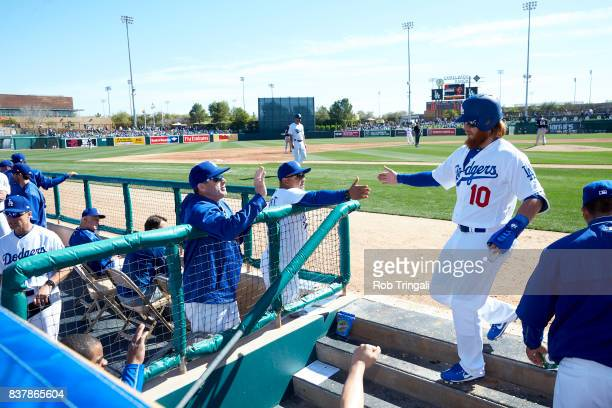 MLB Season Preview Los Angeles Dodgers manager Dave Roberts victorious with Justin Turner during spring training game at Camelback RanchGlendale...