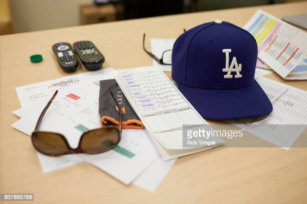 MLB Season Preview View of Los Angeles Dodgers manager Dave Roberts' desk in his office with cap sunglasses and lineup card during spring training...
