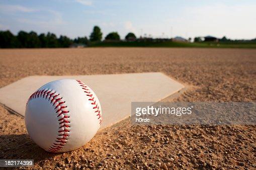 A baseball Near a diamond on a baseball field