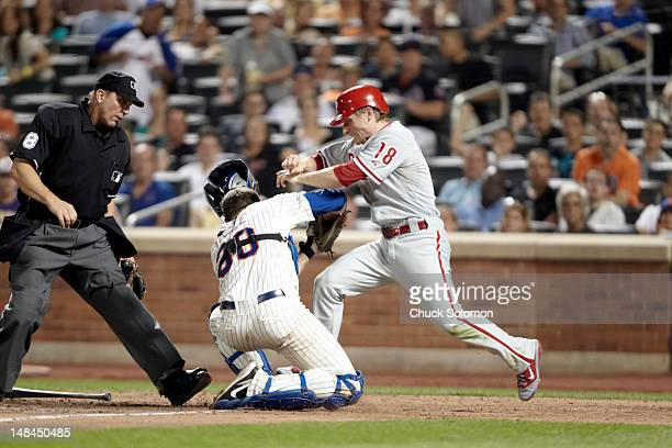 New York Mets Josh Thole in action tagging out Philadelphia Phillies Mike Fontenot at home plate at Citi Field Flushing neighborhood of the Queens...