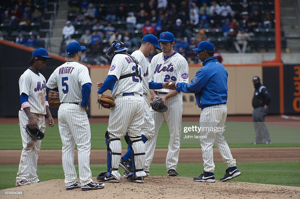 New York Mets manager Jerry Manuel (53) making pitching change with Oliver Perez (46) during game as Jose Reyes (7), David Wright (5), Rod Barajas (21), and Ike Davis (29) look on from mound vs San Francisco Giants. Flushing, NY 5/9/2010