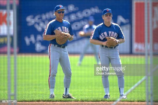 New York Mets pitching coach Mel Stottlemyre with manager Jeff Torborg during spring training before game vs Montreal Expos at Thomas J White Stadium...