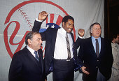 New York Yankees Dave Winfield with owner George Stenbrenner and agent Al Frohman after signing a free agent contract with the Yankees during...