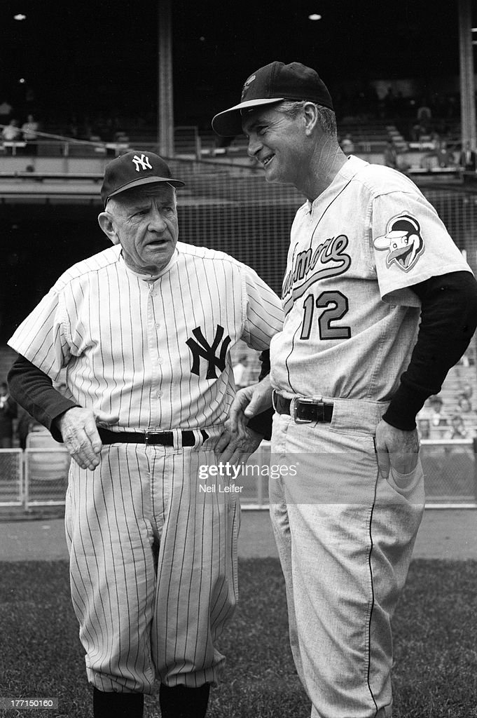 New York Yankees manager Casey Stengel (37) and Baltimore Orioles manager Paul Richards (12) on field before game at Yankee Stadium. Neil Leifer F18 )